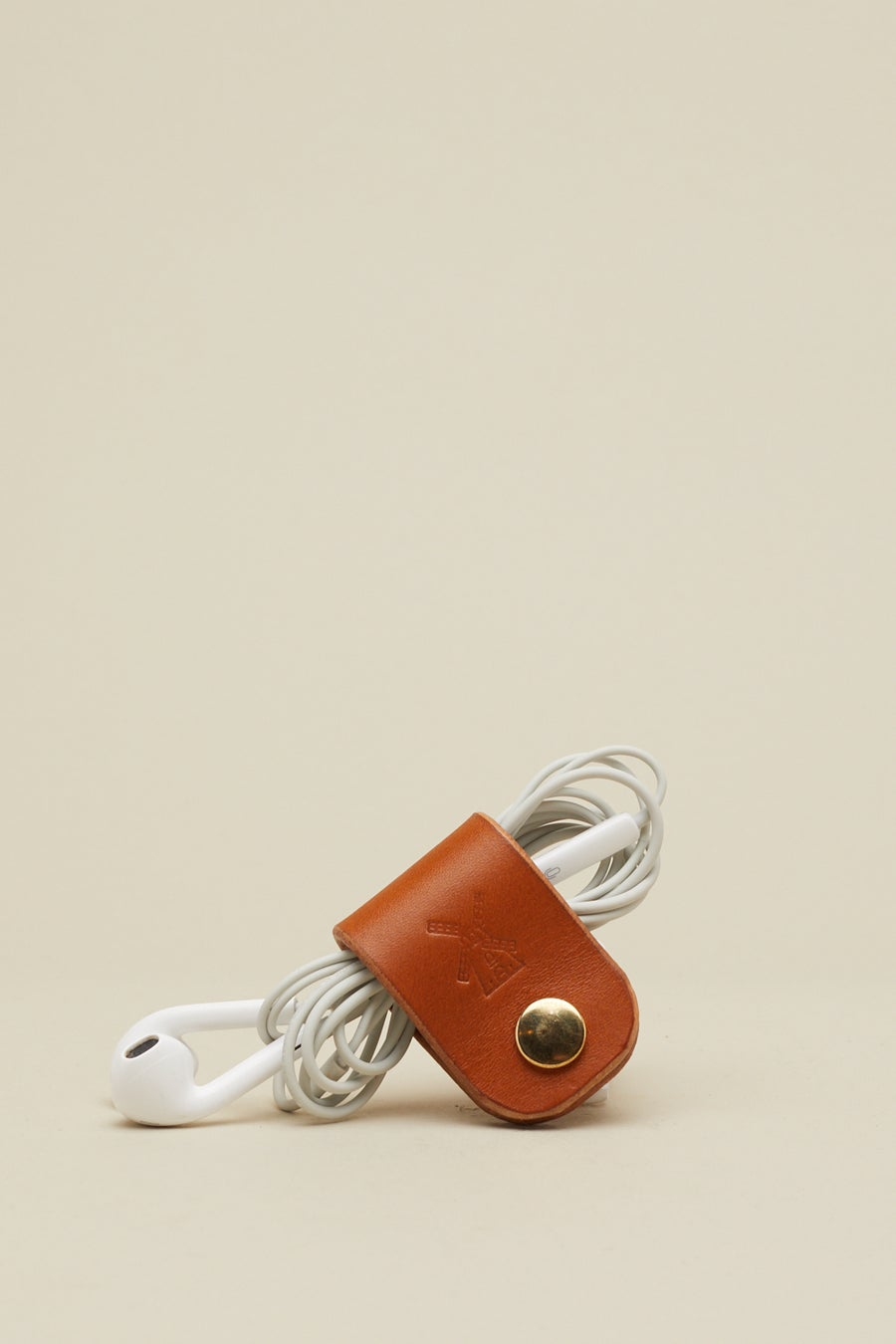Image of Earphone Holder in Tan