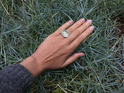 Image of silver ring with prehnite and inscription in Latin