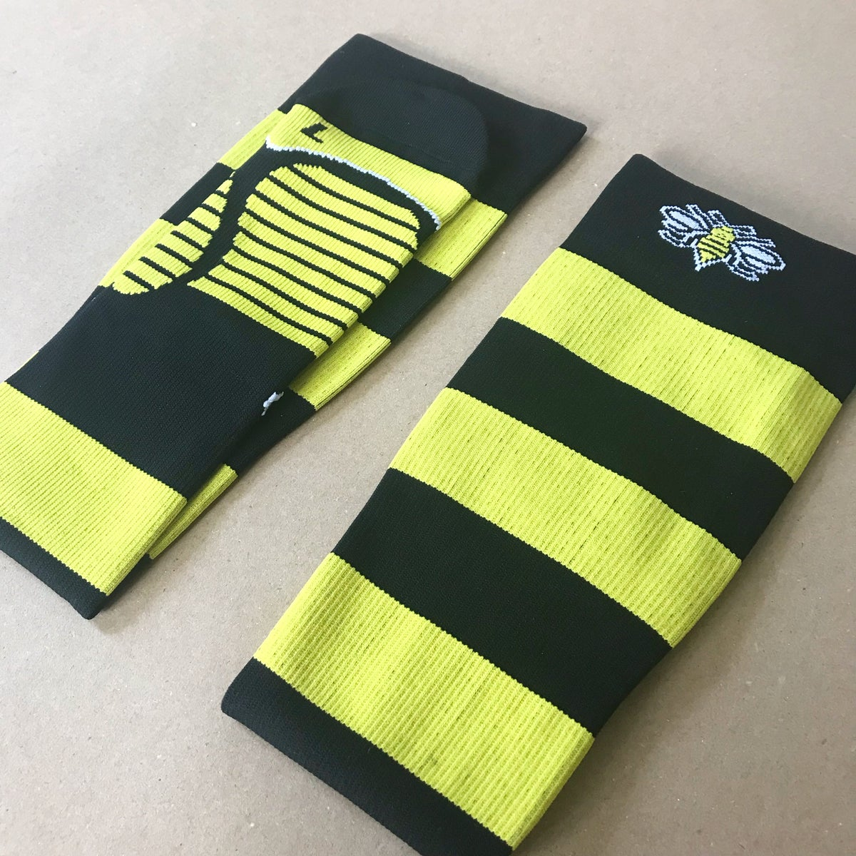 Image of BeesKnees Long Striped Compression Running Socks in Yellow + Black