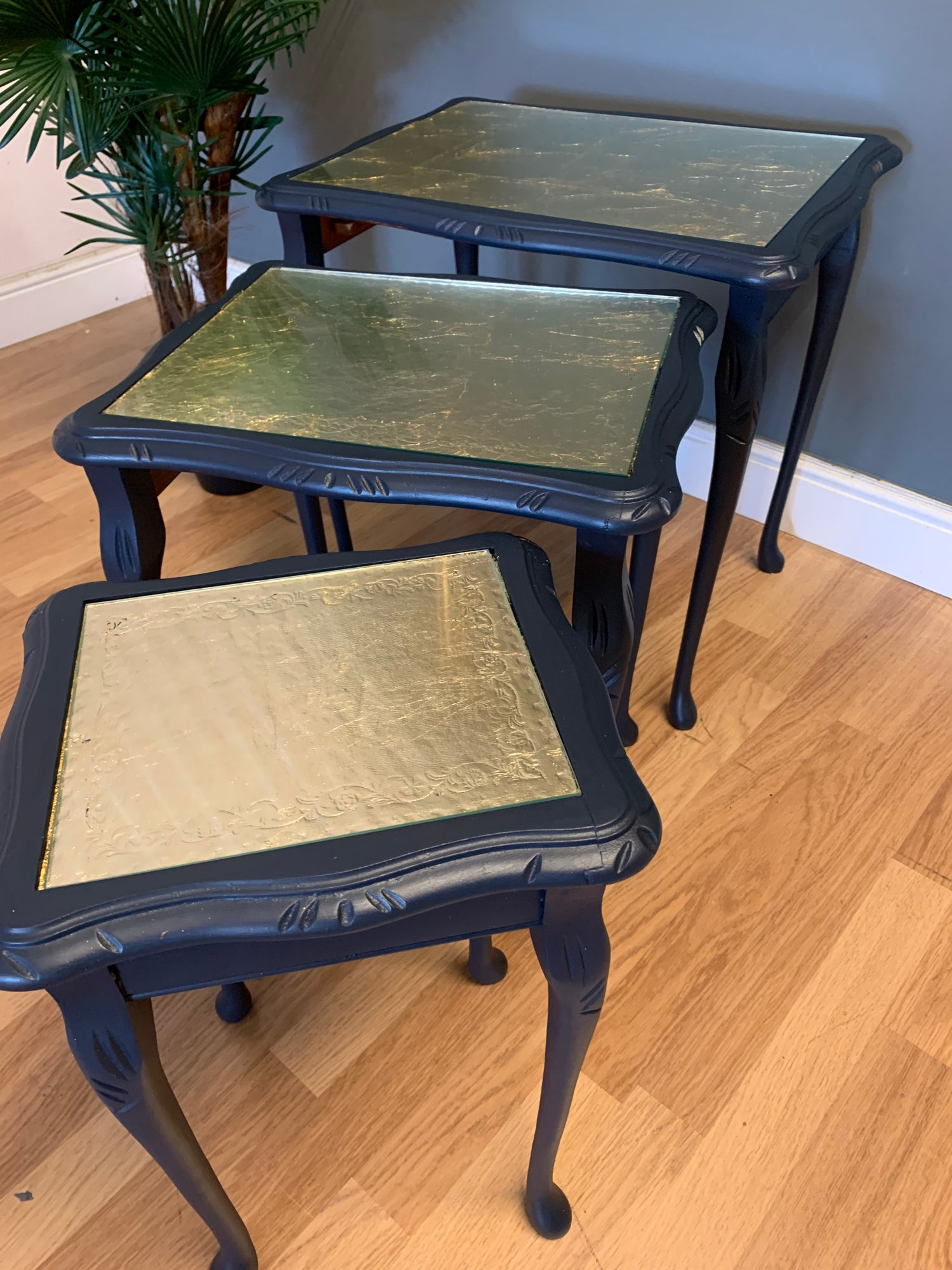 Image of A nest of tables in dark blue & gold leaf.
