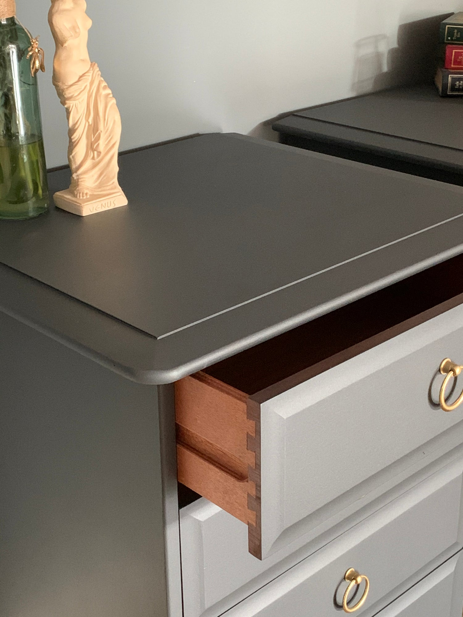 Image of A pair of dark grey stag mahogany bedside tables