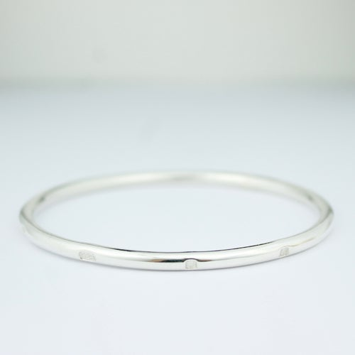 Image of Chunky round sterling silver feature hallmark bangle