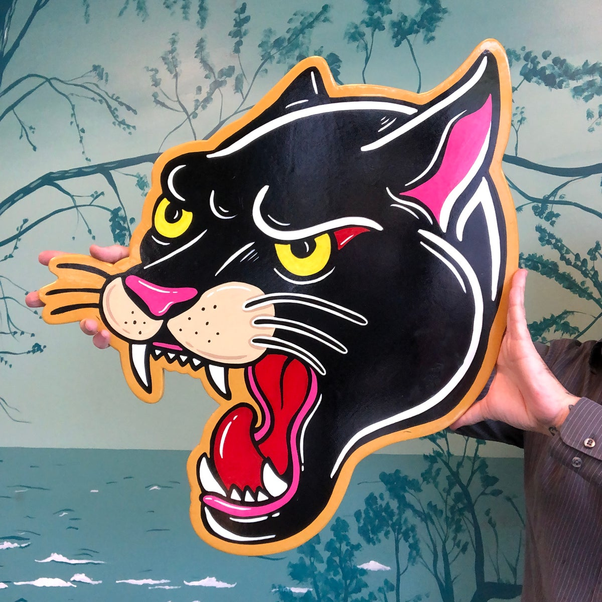 Image of Panther head. Hand painted wood cut out sign
