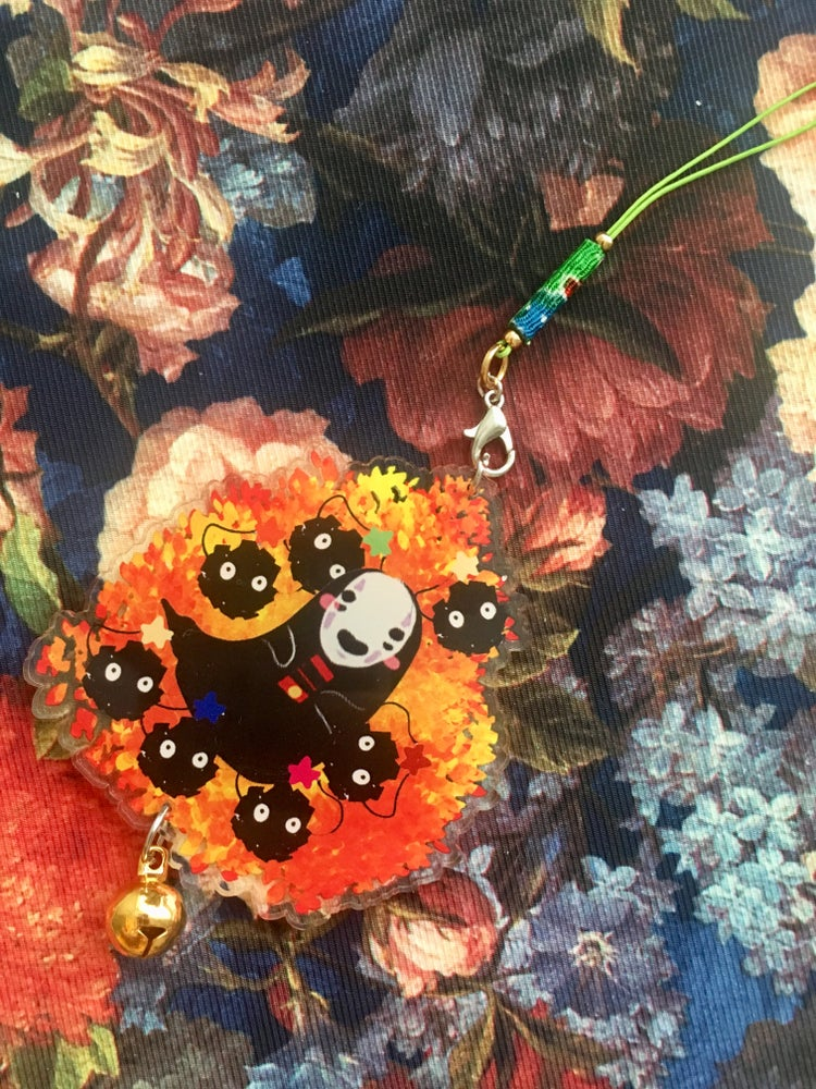 Image of no face + soot sprite charm