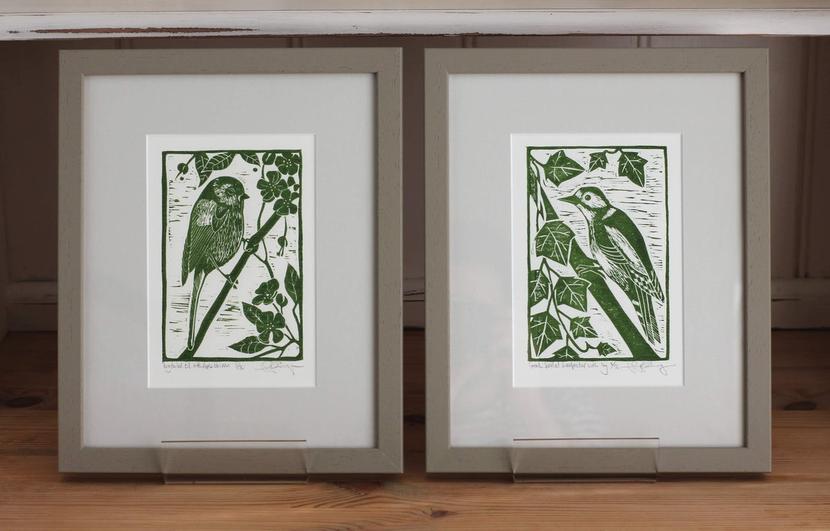 Image of 'Long tailed tit with apple blossom and Great spotted woodpecker with Ivy'