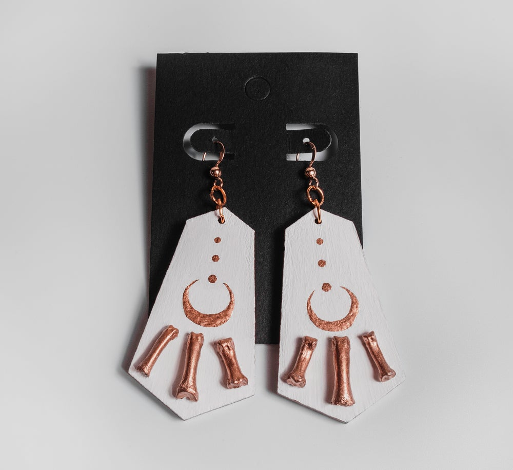 Image of Matte White + Gold Raccoon Toe Bone Earrings