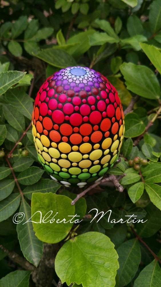 Image of Rainbow dot art Painted egg-shaped stone by Alberto Martin