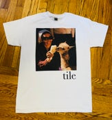 Image of tile grooming t-shirt