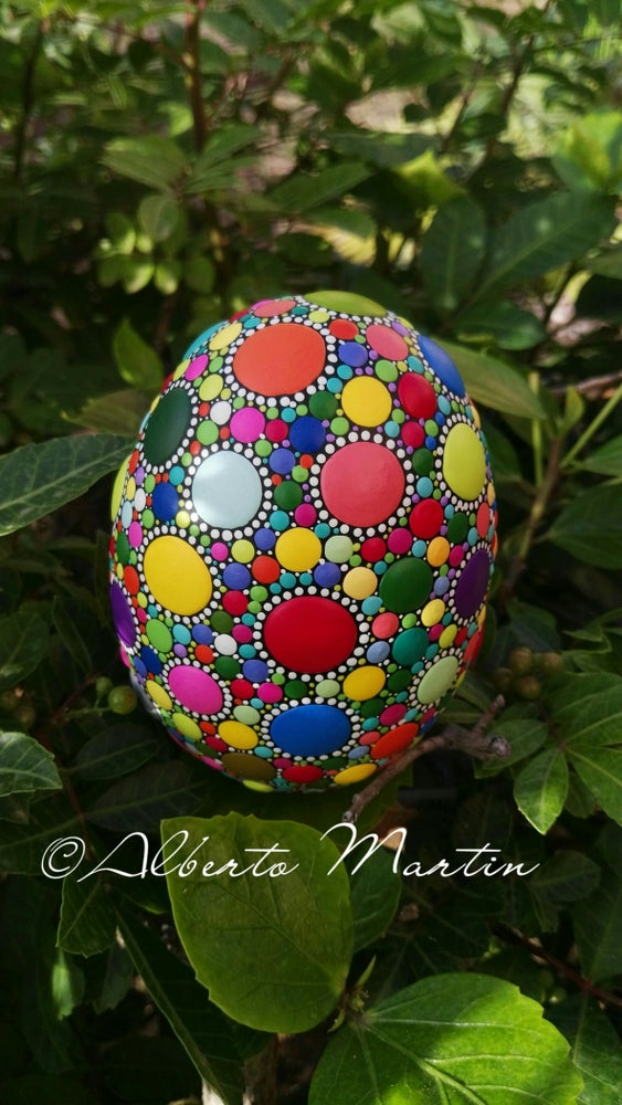 Image of Multicolored dot art painted egg-shaped stone BY ALBERTO MARTIN