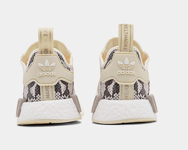 Image of Swarovski Adidas NMD Womens Casual Shoes White/Snake Print customized with Swarovski Crystals.