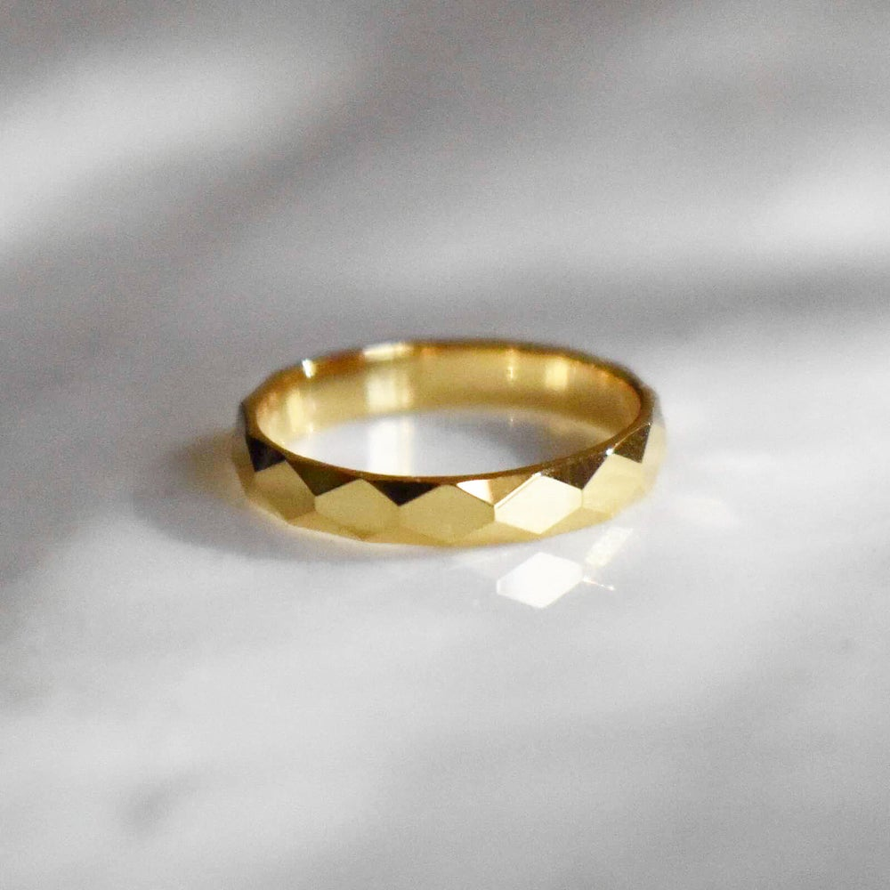 Image of 14k solid gold faceted cut ring
