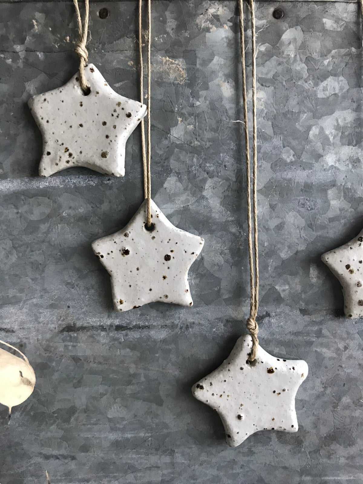 Image of Set of five speckled christmas star ornaments