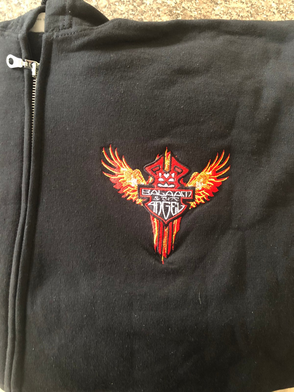 Image of Flame design hoodie with embroidered logo