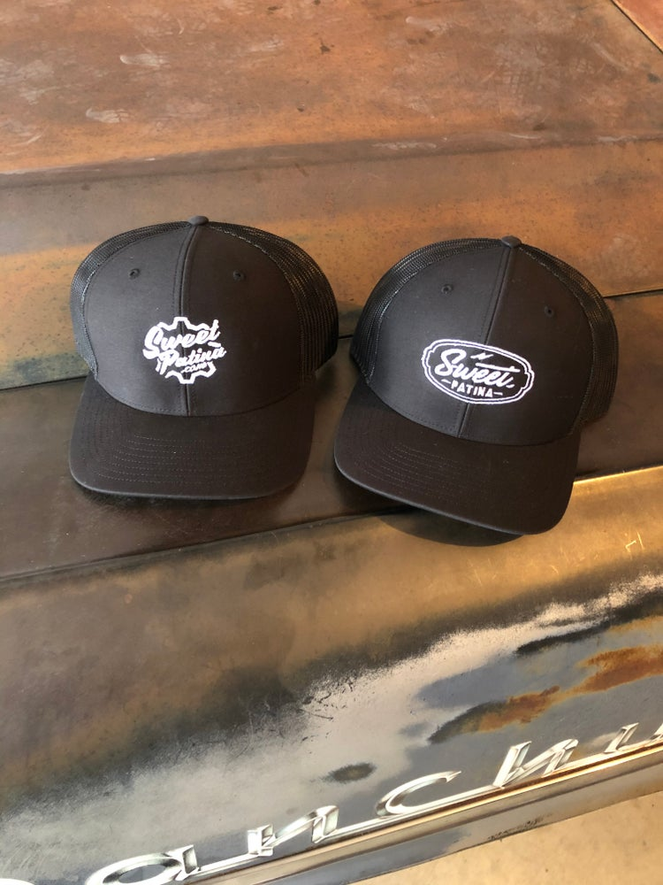 Image of Solid Black SMALL  logo trucker Hat