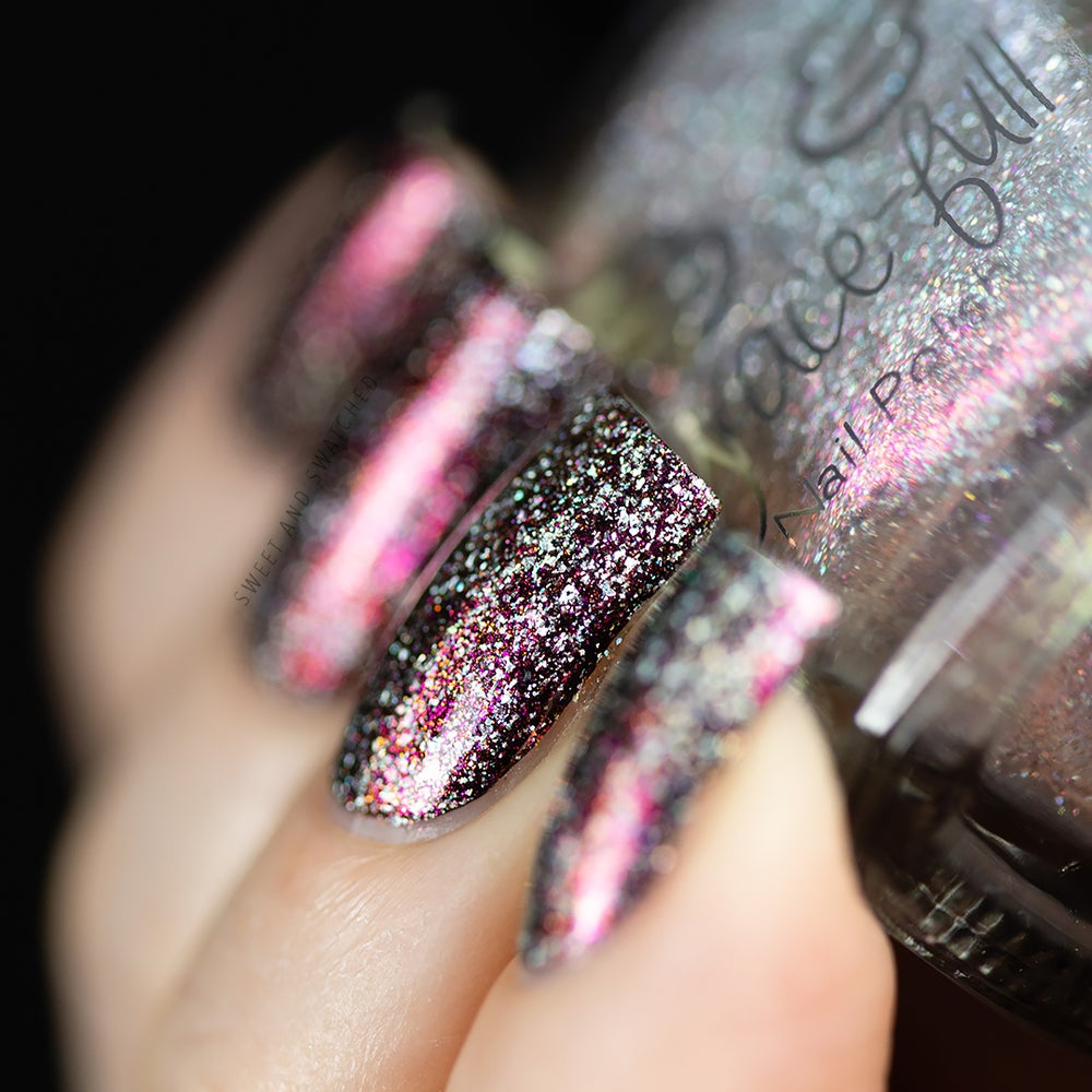 Image of Dumbledore's Present is a topper, it has red-pink aurora shimmer and holo flakes