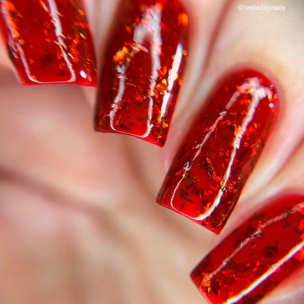 Image of Love Mum a deep red jelly base with red and gold flakies.