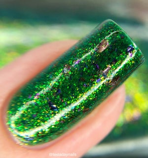 Image of  Frogs Choir a rich green  with a gold shimmer flash and UCC flakes in purple, pink, blue and gold