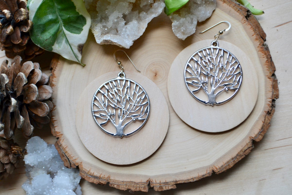 Image of Wood earrings with tree of life over top
