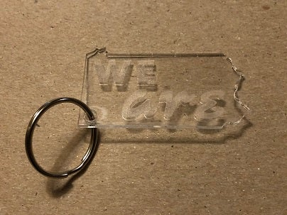 "Image of Clear Acrylic ""We Are"" Keychain"