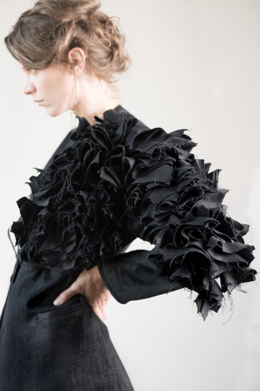 Image of One arm flowers coat