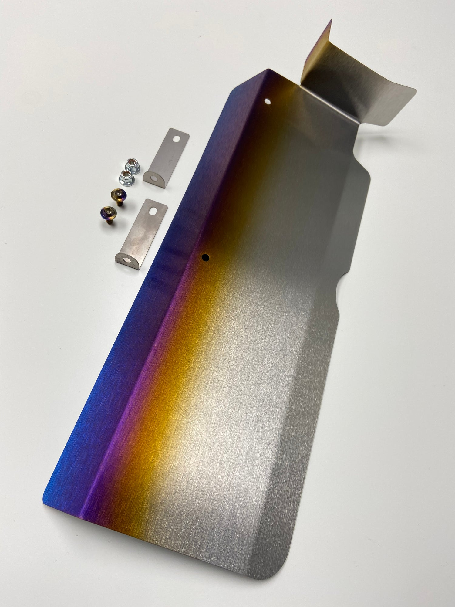 Image of Mitsubishi Evo 8/9 titanium valve cover and cam position heatshield.