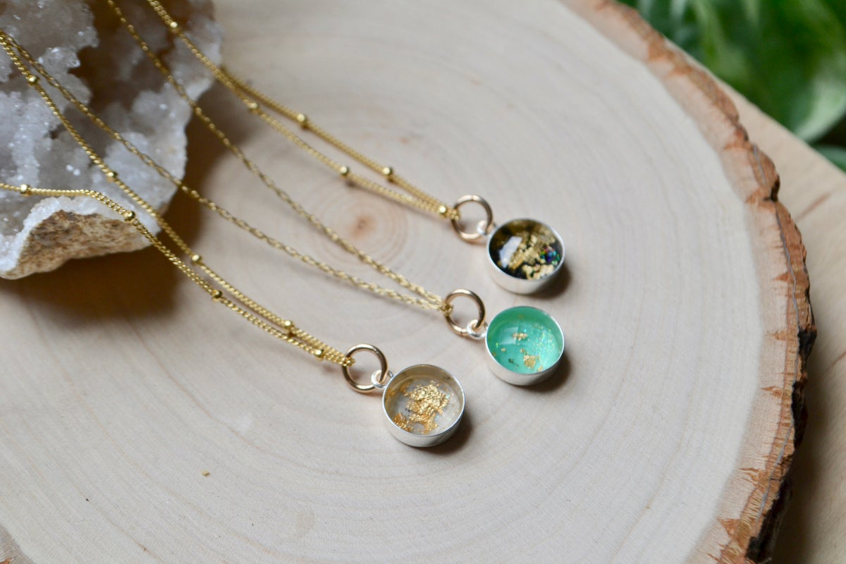 Image of Resin pendants with gold flakes inside them