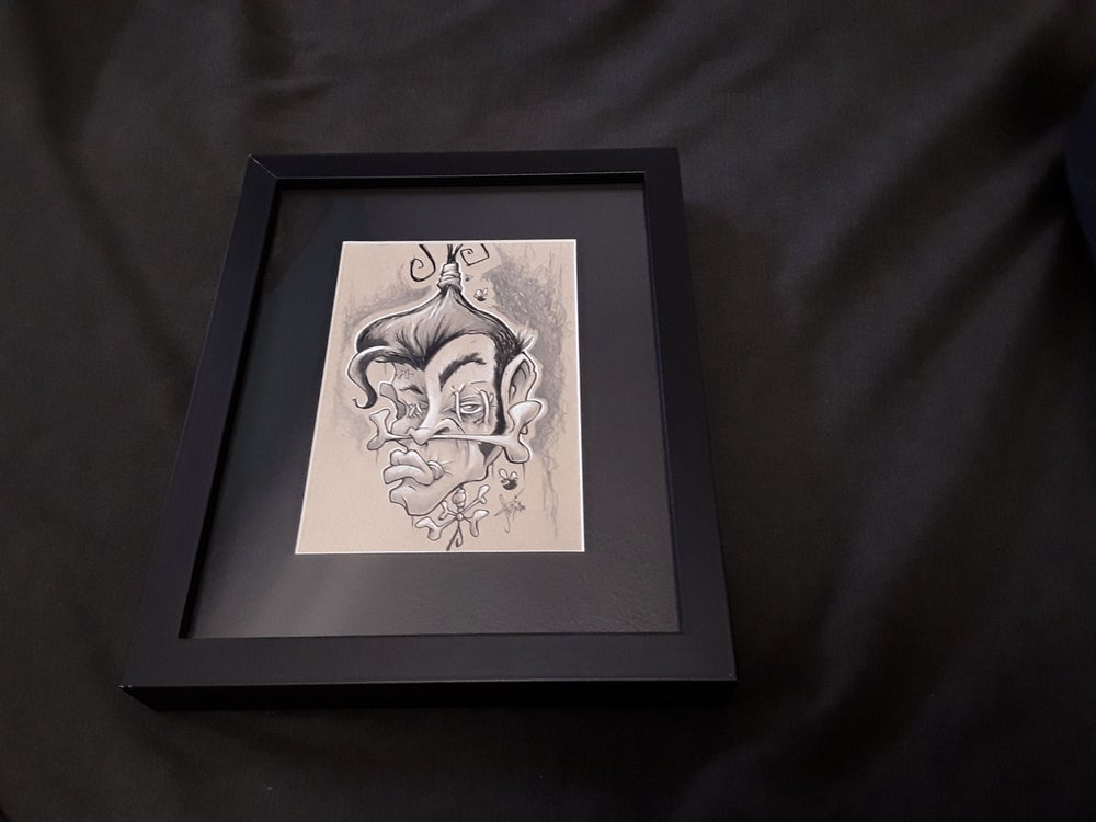 Image of Shrunken Elvis head ink drawing