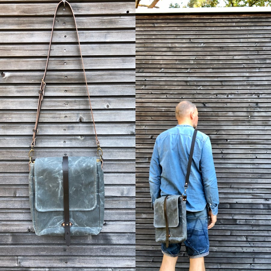 Image of Messenger bag in waxed canvas with leather adjustable shoulder strap and closing flap