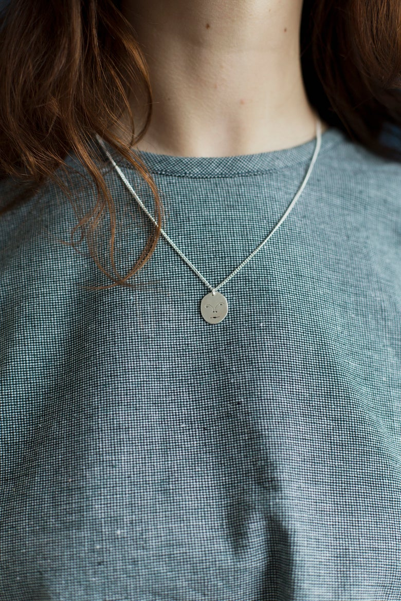 Image of moon face necklace