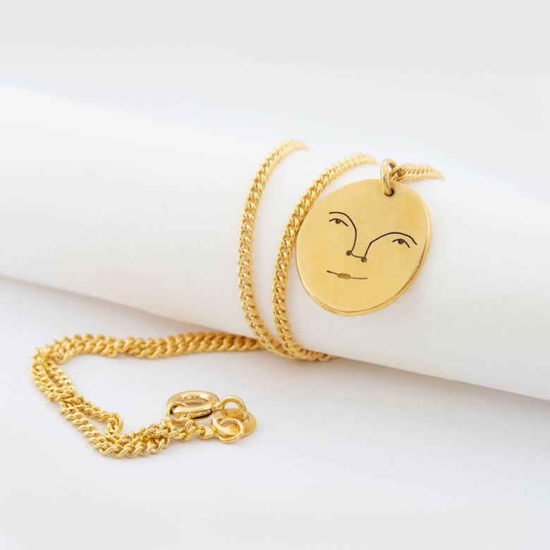 Image of sun face necklace