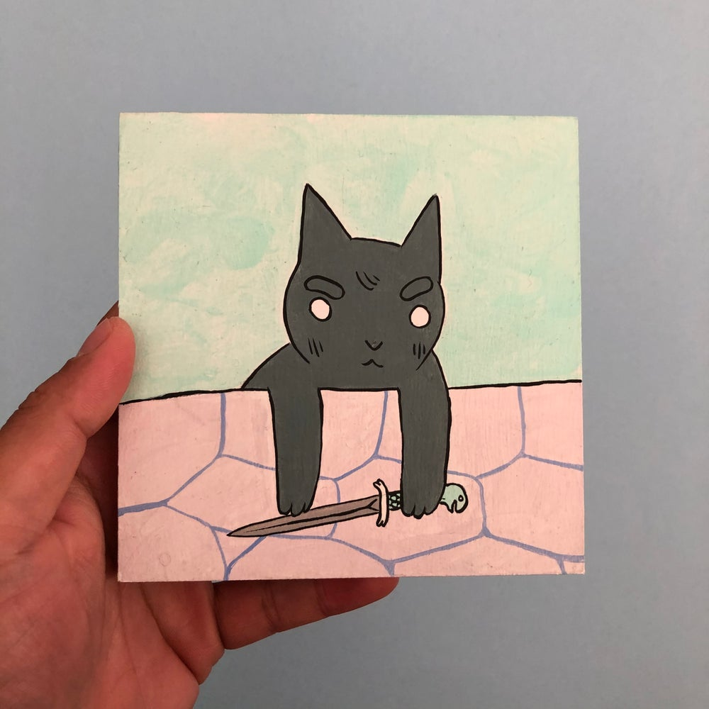 Image of Cat Looking Over Wall with Knife