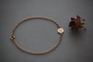 Image of 9ct rose gold, botanic lavender engraved disc bracelet