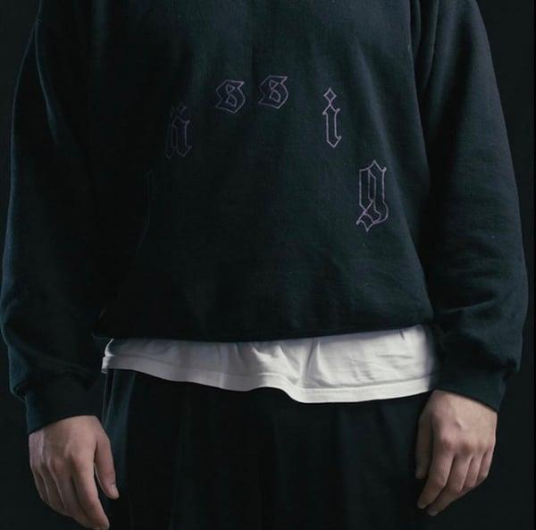 Image of tatt sweater