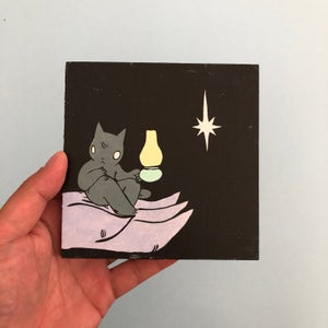 Image of Giant holding Cat with Lantern