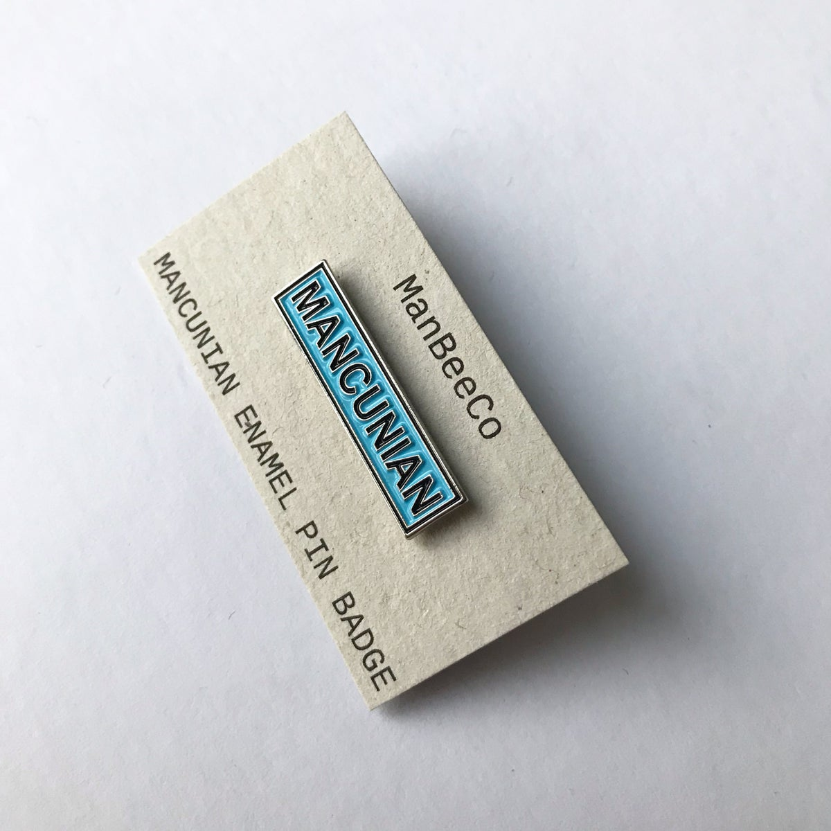 Image of MANCUNIAN ENAMEL BAR PIN BADGE IN BLUE