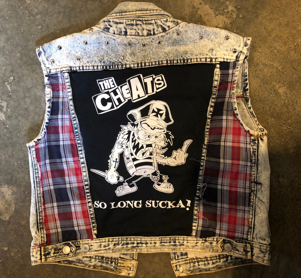 The Cheats custom acid wash denim w/hand studding