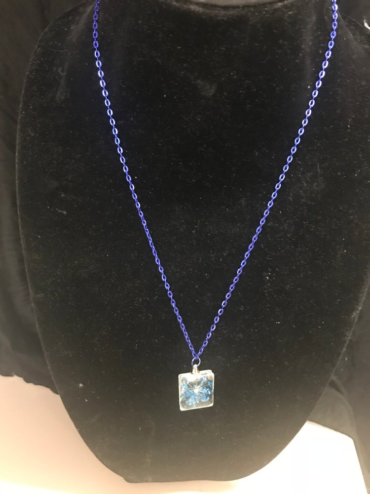 Image of Crystal pendant with an encrusted blue tree