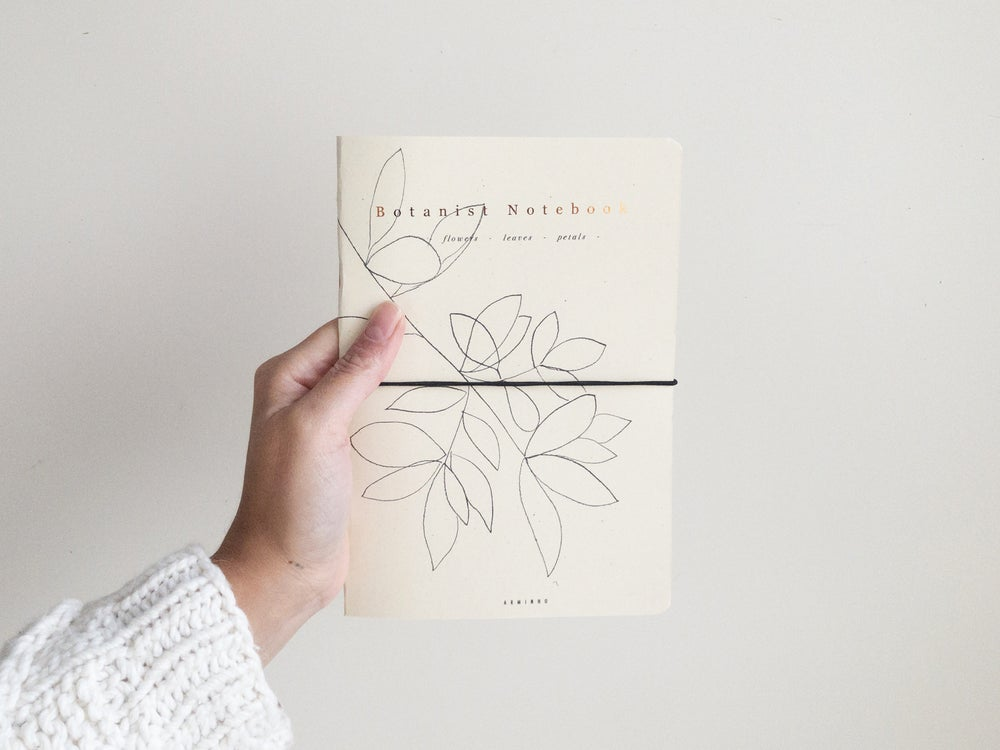 Image of The Botanist Notebook, pressed flowers, leaves and plants, botanical journal, field notes