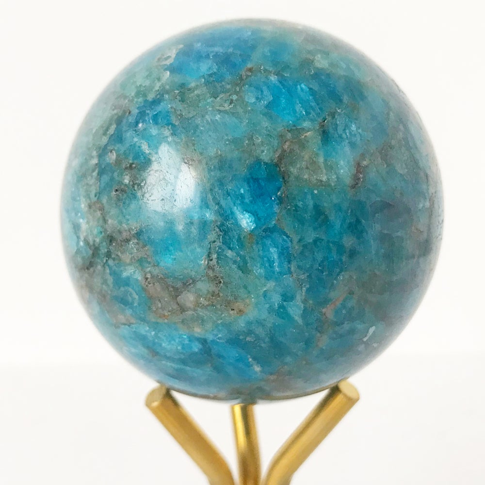 Image of Polished Apatite Sphere no.01 + Lucite and Brass Stand