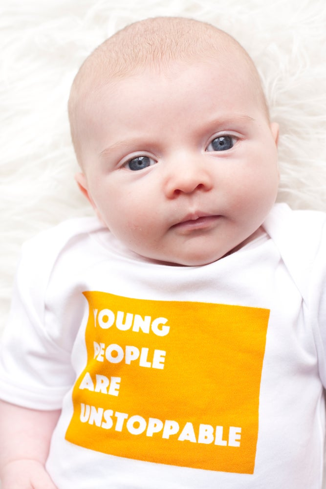 Image of YOUNG PEOPLE ARE UNSTOPPABLE organic cotton baby bodysuit