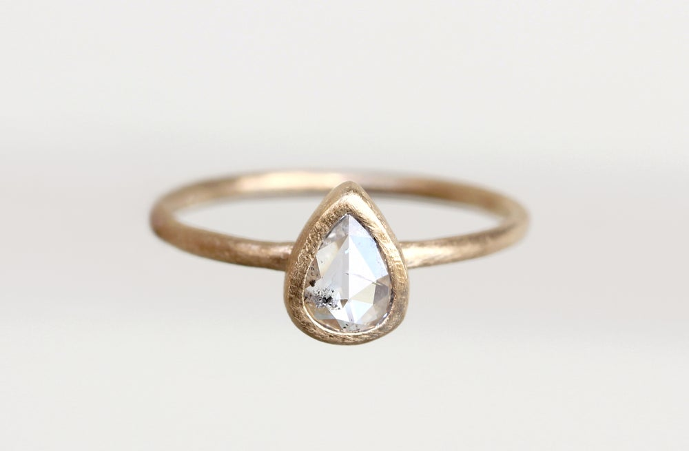 Image of Pear diamond engagement ring. Salt and Pepper. Escondido