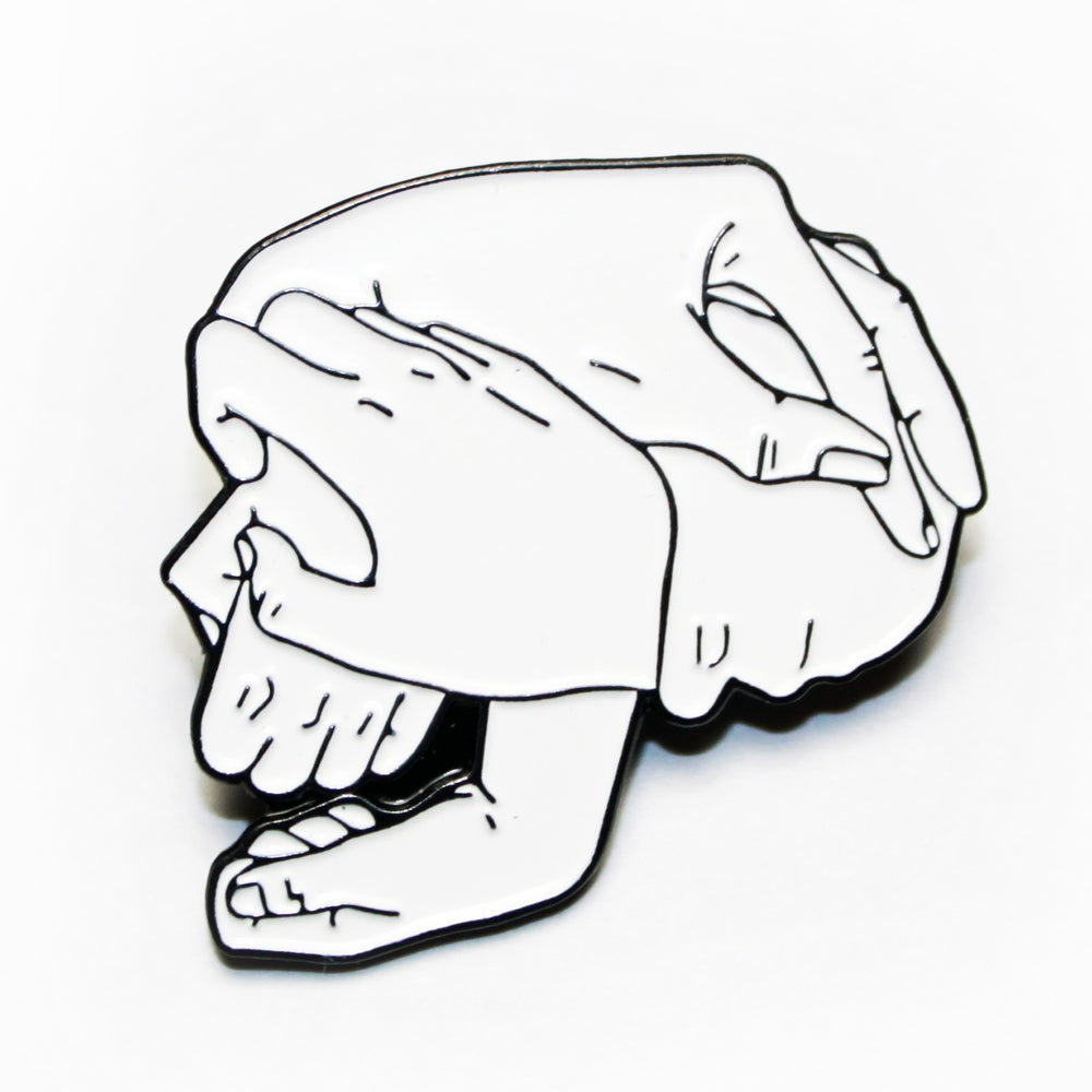 Image of skull hands pin