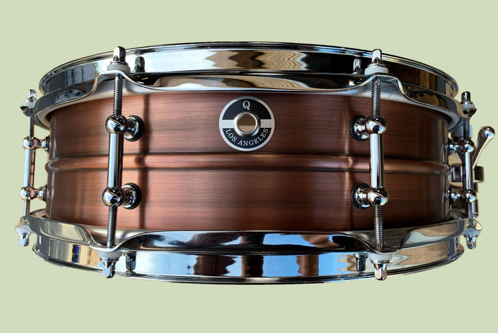Image of 4.5x14 Copper Shell with 10 ply Maple re-rings