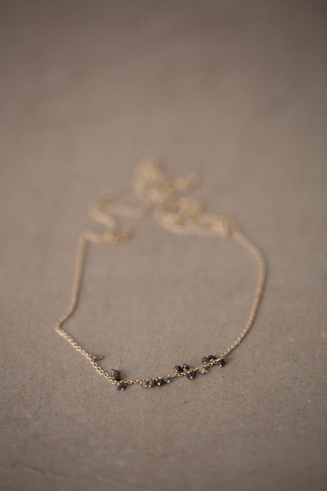 Image of Necklace with a series of grey & black raw diamonds by Stephanie Schneider