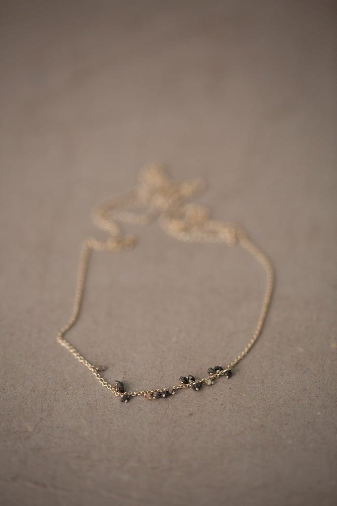 Image of Necklace with a series of grey & black raw diamonds by Stephanie Schneider