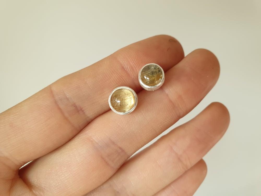 Image of Brazilian rutile quartz cabochons set in sterling silver studs.