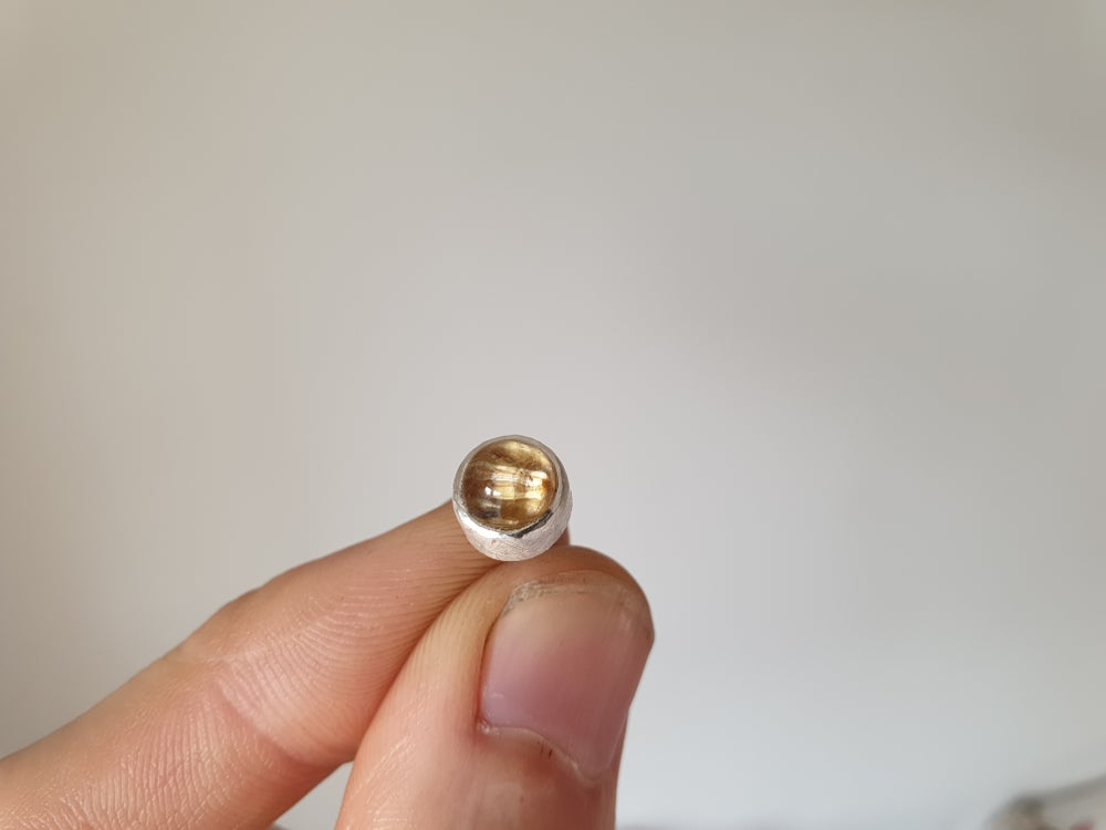 Image of Single rutile quartz cabochon stud