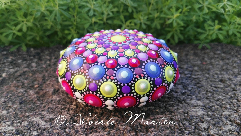 Image of Multicolored Mandala painted stone.