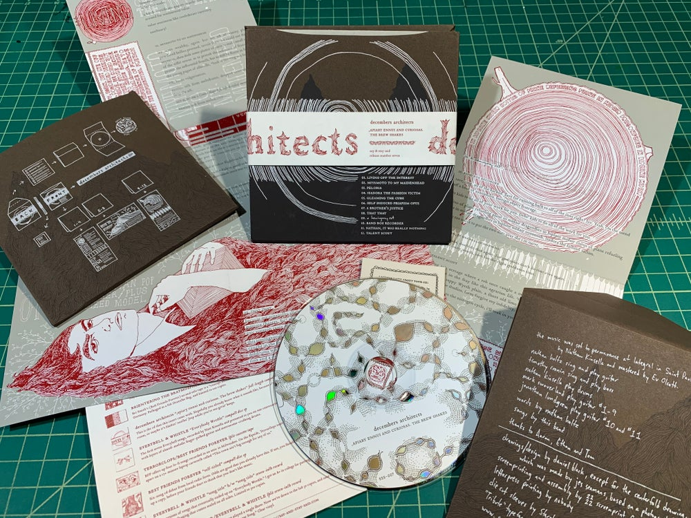 "decembers architects ""',apiary ennui and curiosas. The brew shakes"" CD w/handmade packaging"