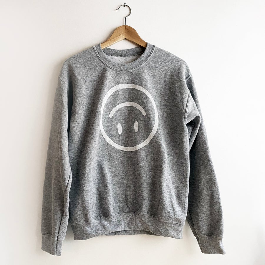 Image of UPSIDE DOWN HAPPY FACE  SWEATSHIRT / IN HEATHER GREY